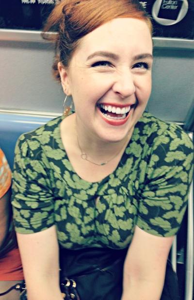 Sarah Kit Farrell laughing | MindBodyPlate